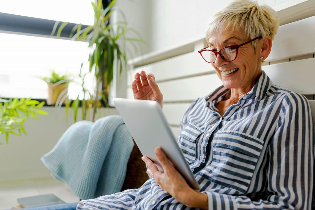 Woman at home working on a tablet.